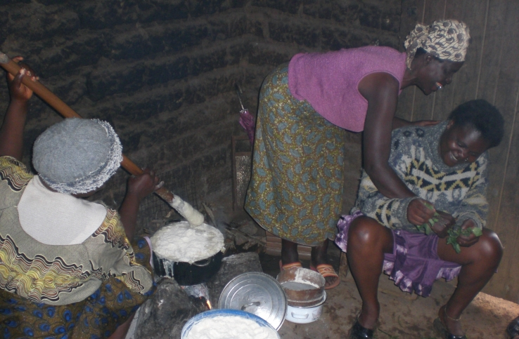 Village women cooking. fullsize. This image was re-sized to be displayed.